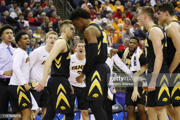 The Iowa Hawkeyes celebrate during the second half against the Cincinnati Bearcats in the first round of the 2019 NCAA Men's Basketball Tournament at...