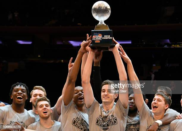 The Iowa Hawkeyes celebrate the win of the championship game against the Connecticut Huskies during the 2K Empire Classic at Madison Square Garden on...