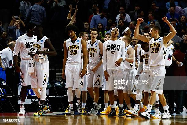 The Iowa Hawkeyes celebrate their 72 to 70 win over the Temple Owls in overtime during the first round of the 2016 NCAA Men's Basketball Tournament...