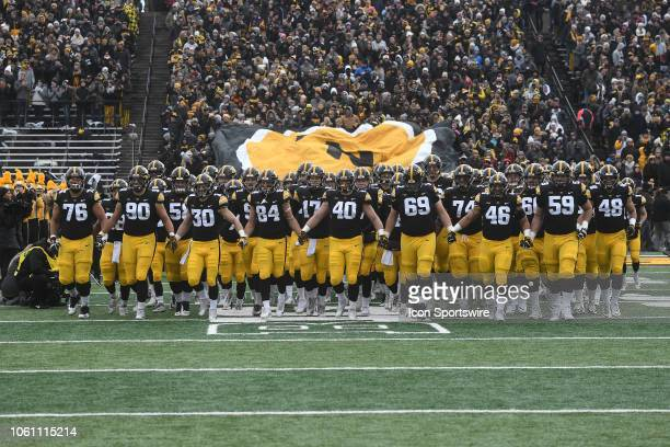 The Iowa Hawkeyes enter the field before a Big Ten Conference football game between the Northwestern Wildcats and the Iowa Hawkeyes on November 10...