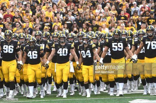 The Iowa Hawkeyes take the field before a non conference college football game between the Iowa State Cyclones and the Iowa Hawkeyes on September 08...
