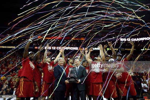 The Iowa State Cyclones celebrate after defeating the West Virginia Mountaineers to win the championship game of the Big 12 Basketball Tournament at...