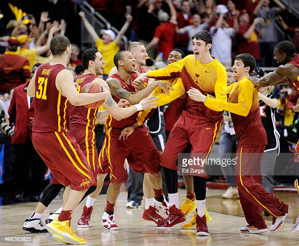 The Iowa State Cyclones celebrate their 70 to 66 win over the Kansas Jayhawks during the championship game of the Big 12 Basketball Tournament at...