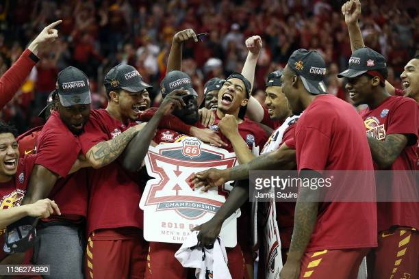 The Iowa State Cyclones celebrate with Marial Shayok after he is named MVP after defeating the Kansas Jayhawks 7866 to win the Big 12 Basketball...