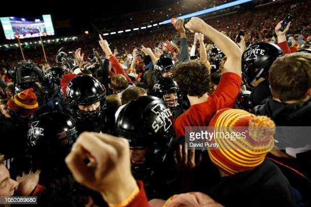 The Iowa State Cyclones celebrates with fans that stormed the field after they Cyclones defeated the West Virginia Mountaineers 3014 at Jack Trice...