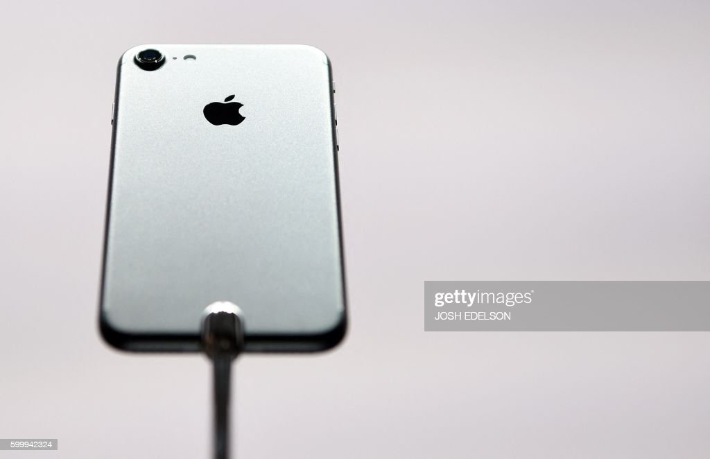 The iPhone 7 is seen on display during an Apple media event at Bill Graham Civic Auditorium in San Francisco, California on September 7, 2016. Apple on Wednesday unveiled two upgraded versions of its iPhone and a new waterproof smartwatch, seeking to reignite growth for the iconic technology maker. The iPhone 7 and larger iPhone 7 Plus, with new camera technology, 50-meter water resistance and other features, were the highlight of an Apple media event in San Francisco. PHOTO / Josh Edelson / The erroneous mention[s] appearing in the metadata of this photo by Josh Edelson has been modified in AFP systems in the following manner: (iPhone 7] instead of [iPhone 7 Plus]. Please immediately remove the erroneous mention[s] from all your online services and delete it (them) from your servers. If you have been authorized by AFP to distribute it (them) to third parties, please ensure that the same actions are carried out by them. Failure to promptly comply with these instructions will entail liability on your part for any continued or post notification usage. Therefore we thank you very much for all your attention and prompt action. We are sorry for the inconvenience this notification may cause and remain at your disposal for any further information you may require.
