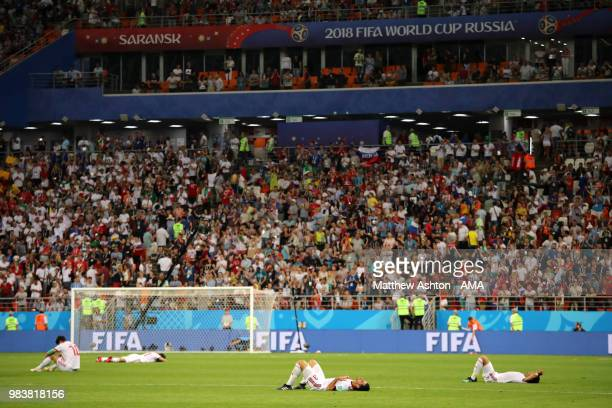 The IR Iran players lie dejectedly on the pitch at the end of the 2018 FIFA World Cup Russia group B match between Iran and Portugal at Mordovia...