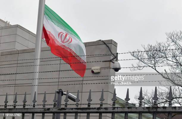 The Iranian flag flas at halfmast at their embassy in Berlin on January 3 2020 following the killing of Iranian commander Qasem Soleimani Germany...