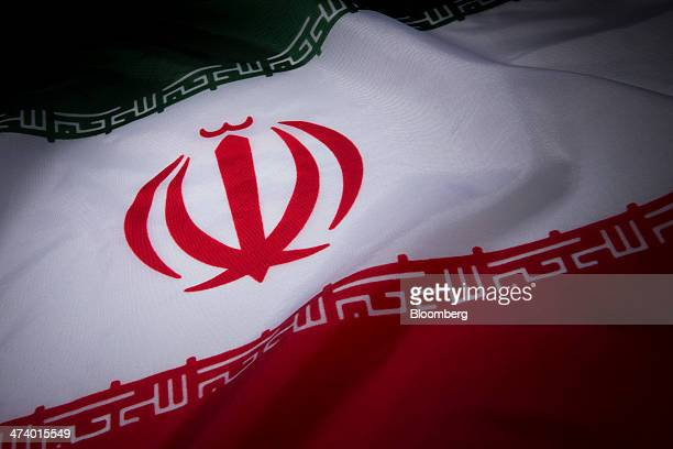 The Iranian flag is arranged for a photograph in New York US on Wednesday Feb 19 2014 Iran and six world powers yesterday agreed in Vienna on a...