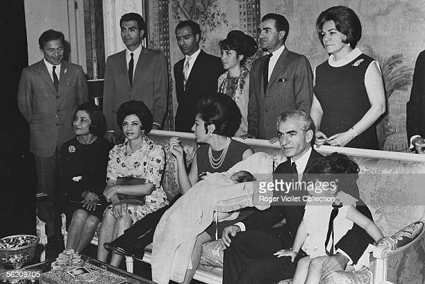The iranian imperial family Standing up from left to right the doctor Bouchehry husband of the Ashraf princess the prince Mohammed Reza the prince...