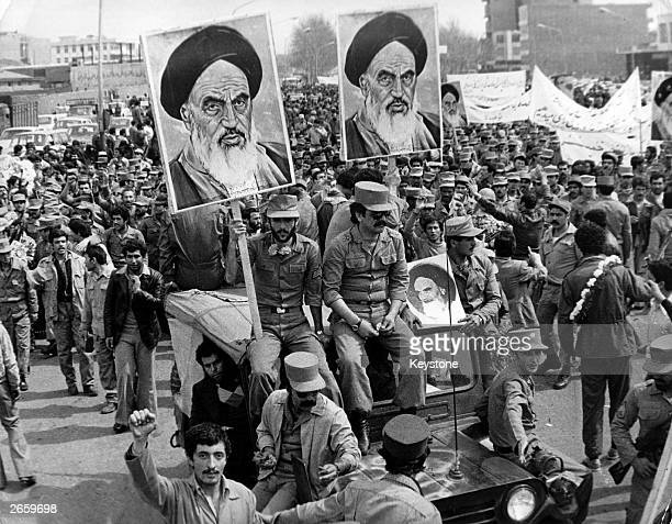 The Iranian Islamic Republic Army demonstrates in solidarity with people in the street during the Iranian revolution. They are carrying posters of...