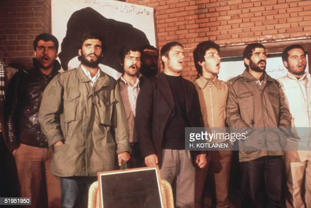 The Iranian students who have occupied the US Embassy in Tehran are singing during the second released group of US Embassy staffers hold a press...