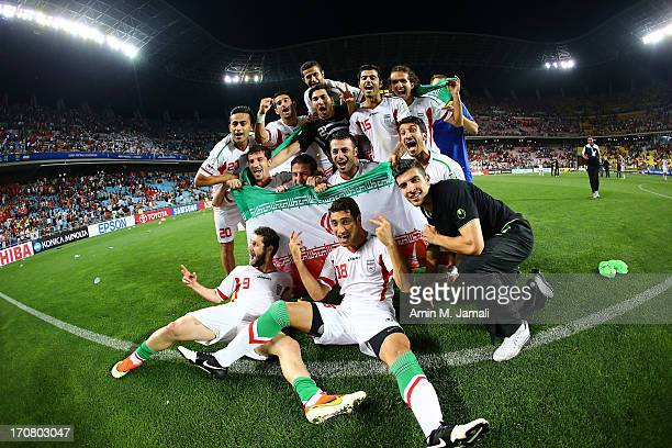 The Iranian team celebrate qualifying for the 2014 FIFA World Cup following the FIFA 2014 World Cup Qualifier match between South Korea and Iran at...