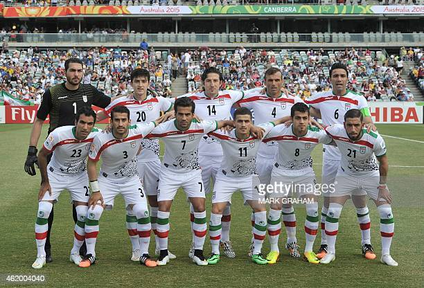 The Iranian team pose before the start of the Asian Cup quarterfinal football match between Iraq and Iran in Canberra on January 23 2015 AFP PHOTO /...