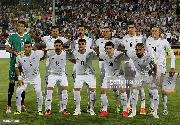 The Iranian team pose for a family picture before a World Cup 2018 Asia qualifying football match between Iran and Qatar at the Azadi stadium in...