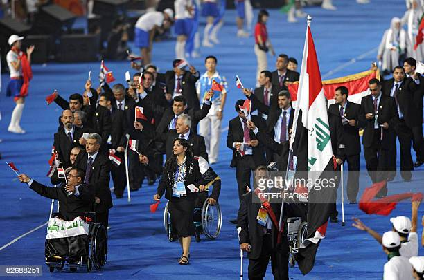 The Iraq delegation parades during the 2008 Beijing Paralympic Games opening ceremony at the National Stadium better known as the Bird's Nest in...