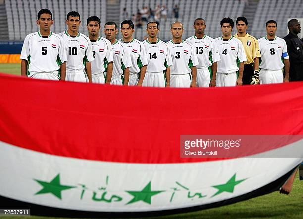 The Iraq soccer team line up in front of their national flag ready to compete in the men's football preliminary match between Iraq and Portugal...