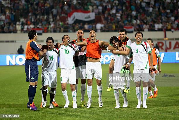 The Iraq team celebrate after the Asian Cup Qualification match between China and Iraq at the AlSharjah Stadium on March 5 2014 in Sharjah United...