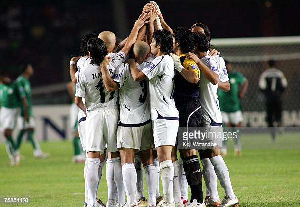 The Iraq team huddle at the start of the second half of the AFC Asian Cup 2007 final between Iraq and Saudi Arabia at Gelora Bung Karno Stadium on...