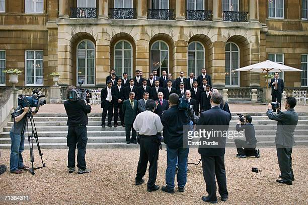 The Iraqi football team pose for a photograph at a Foreign Office reception held in their honour at Lancaster House in London The reception was...