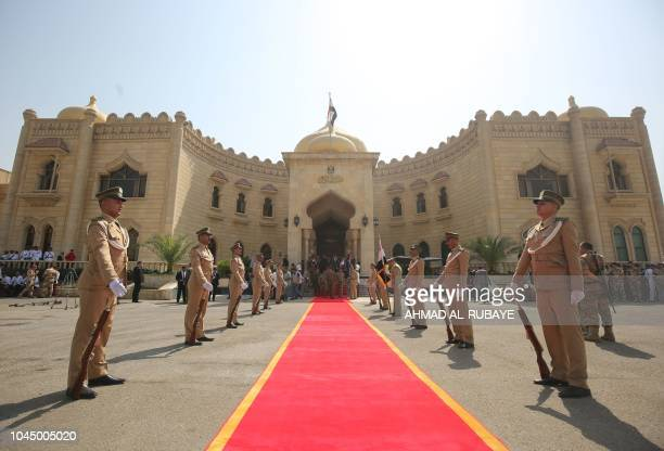 The Iraqi honour guard stand at attention during the presidential handingover ceremony at the presidential palace in Baghdad on October 3 2018...