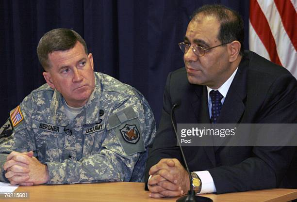 The Iraqi Minister of Electricity Dr Karim Wahid receives questions during a joint press conference with Gen Kevin Bergner the MultiNational Force in...