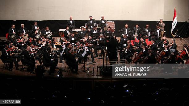 The Iraqi National Symphony Orchestra performs in Baghdad on February 20 during the closing ceremony of the Capital of Arab Culture that was won by...