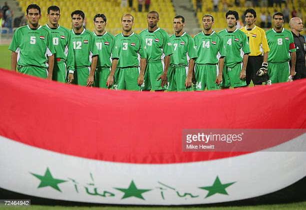 The Iraqi national team lines up for their National Anthem before the men's football semifinal match between Iraq and Paraquay on August 24 2004...