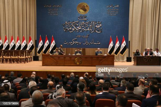 The Iraqi parliament votes on the new Iraqi government headed by Adel Abdul Mahdi October 24 2018 in Baghdad The Iraqi parliament on Thursday...