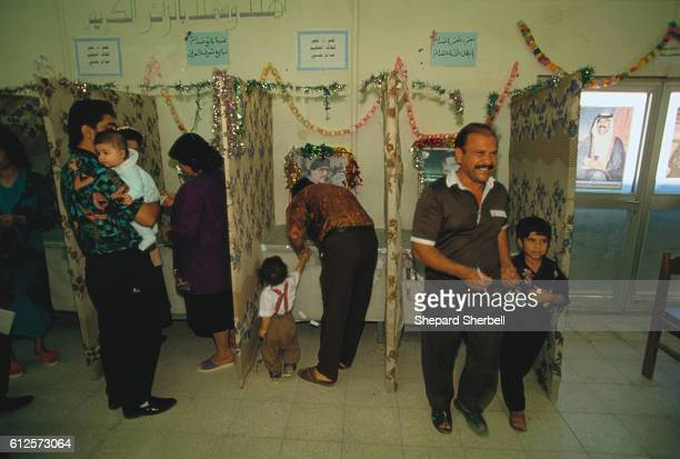 The Iraqi people vote in a presidential referendum on Iraqi President Saddam Hussein No other candidates ran and Saddam won a governmentreported 9996...