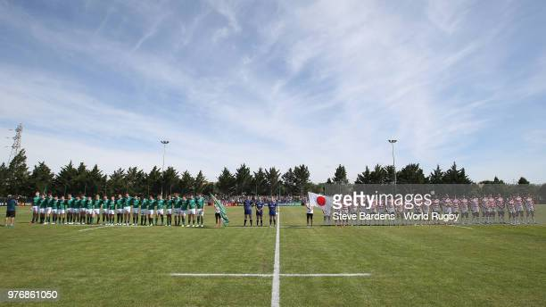 The Ireland and Japan players line up for their national anthems prior to the World Rugby Under 20 Championship 11th Place playoff match between...