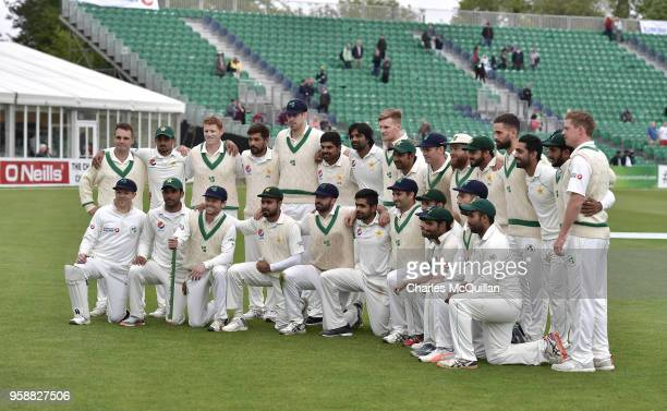 The Ireland and Pakistan cricket teams pose for a photograph following the fifth day of the international test cricket match between Ireland and...