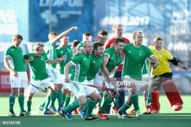 The Ireland team celebrate winning a penalty shoot out during the 5th8th place play off match between Ireland and France on Day 7 of the FIH Hockey...