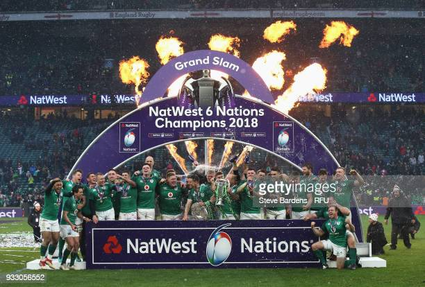The Ireland team celebrate with the NatWest Six Nations trophy and the Triple Crown Trophy after the NatWest Six Nations match between England and...