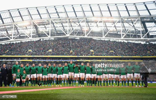 The Ireland Team line up to sing the national anthem during the RBS Six Nations match between Ireland and Italy at Aviva Stadium on March 8 2014 in...