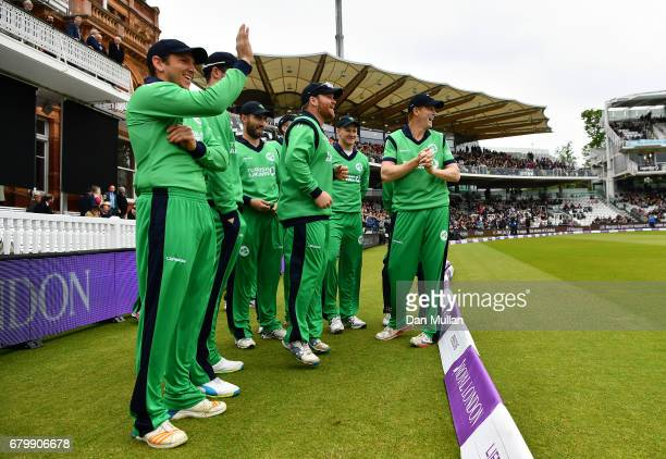 The Ireland team share a joke with the England batsmen prior to the Royal London One Day International between England and Ireland at Lord's Cricket...