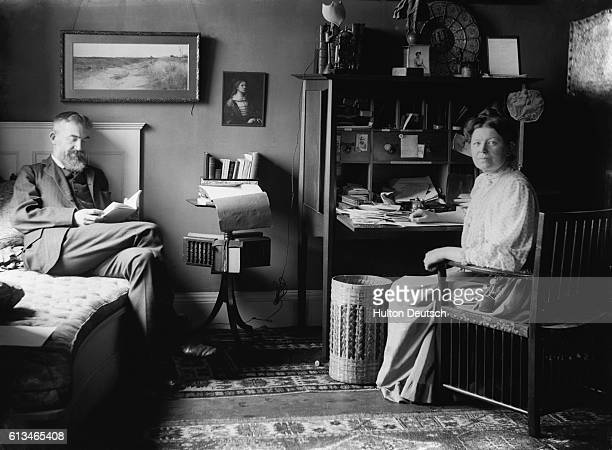 The Irish dramatist George Bernard Shaw at home with his wife in London