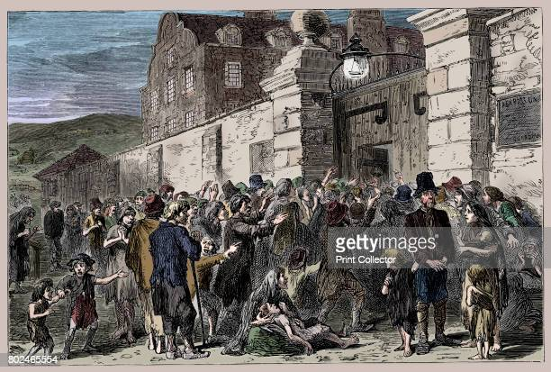 The Irish Famine 18451849 Starving peasants at a workhouse gate Illustration from The life and times of Queen Victoria by Robert Wilson Artist Unknown