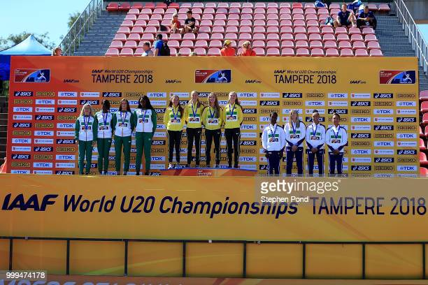 The Irish German and British teams celebrate with their medals during the medal ceremony for the women's 4x100m on day five of The IAAF World U20...