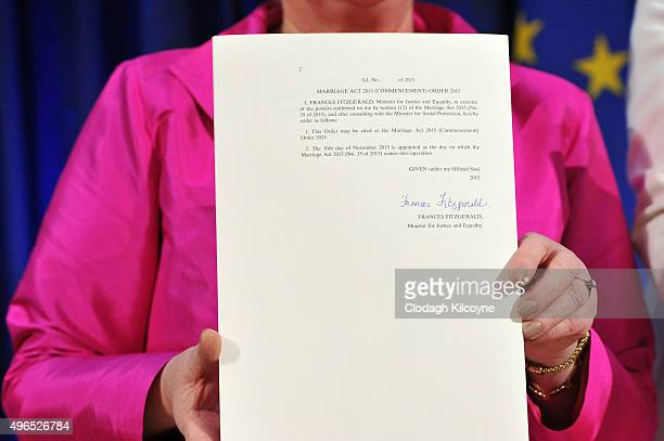 The Irish Minister for Justice and Equality Frances Fitzgerald holds up the signed commencement order for the Marriage Act 2015 and an accompanying...