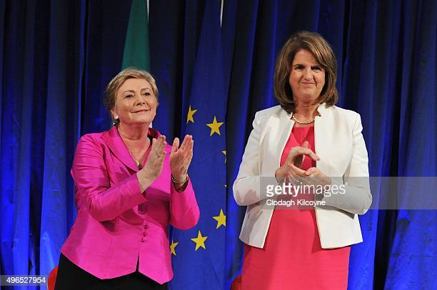 The Irish Minister for Justice and Equality Frances Fitzgerald applauds alongside Tanaiste Joan Burton after signing the commencement order for the...