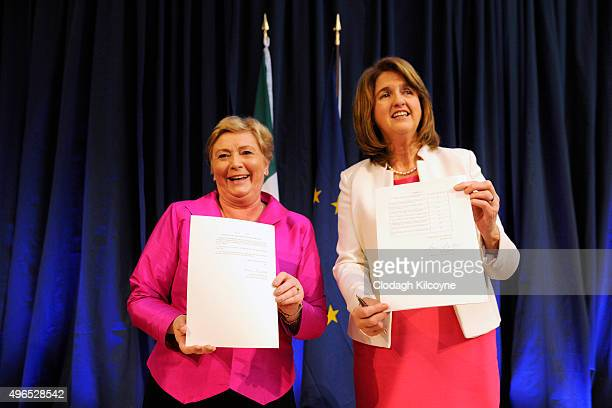 The Irish Minister for Justice and Equality Frances Fitzgerald shows her signed commencement order for the Marriage Act 2015 as the Tanaiste Joan...