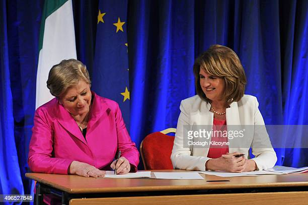 The Irish Minister for Justice and Equality Frances Fitzgerald signs the commencement order for the Marriage Act 2015 and the Tanaiste Joan Burton...