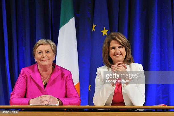 The Irish Minister for Justice and Equality Frances Fitzgerald smiles alongside Tanaiste Joan Burton after signing the commencement order for the...