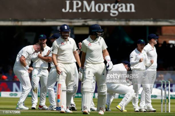 The Irish team celebrate after their appeal for the wicket of England's Joe Root is uphelp on the first day of the first cricket test match between...