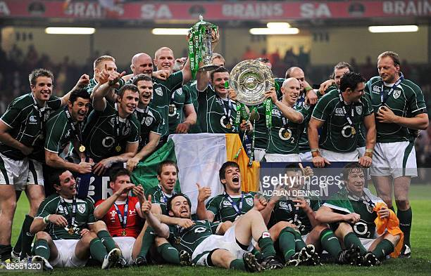 The Irish team celebrate after winning the game against Wales during the Six Nations titledeciding rugby match at the Millennium Stadium in Cardiff...