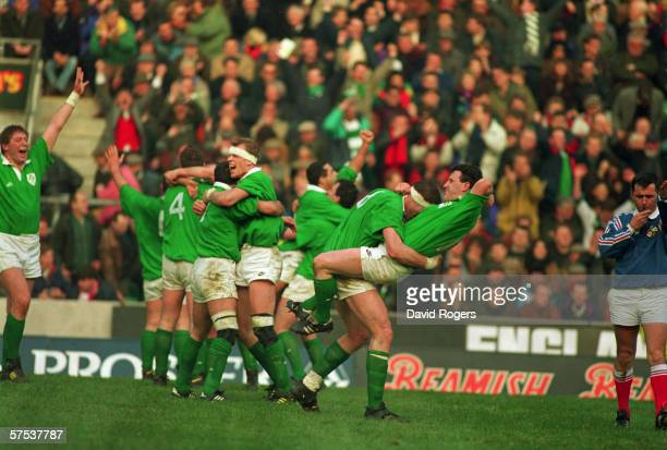 The Irish team celebrate their victory over England in the Five Nations Championships at Twickenham London 19th February 1994 Ireland beat England 13...