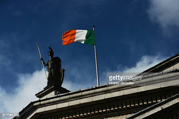 The Irish tricolour flies over the GPO during the 1916 Easter Rising commemoration parade marking the 100th anniversary at the General Post Office...