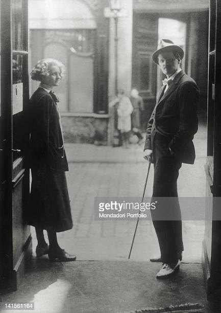 The Irish writer James Joyce posing on Shakespeare and Company bookshop doorstep along with the owner of the bookshop Sylvia Beach Paris 1920s