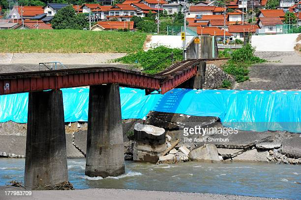 The iron bridge of JR Sanko Line is damaged by the torrential rain on August 25 2013 in Kawamoto Shimane Japan More than 200 houses suffer flooding...